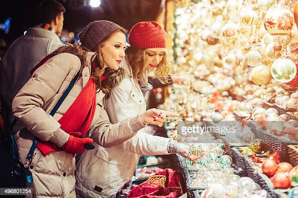 Friends shopping at christmas fair.