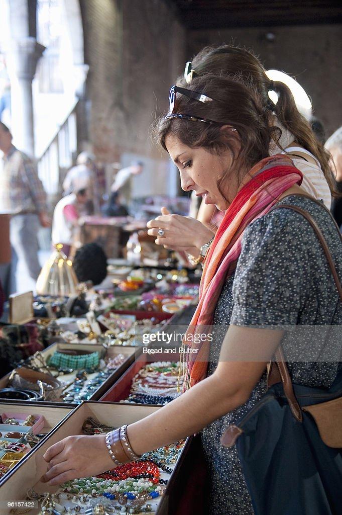 Friends shopping at outdoor flea market : Stock Photo