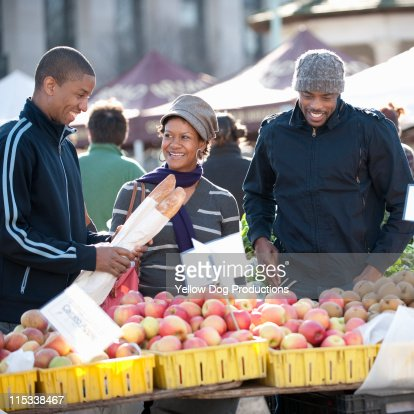 Friends Shopping at Outdoor Market : Stock Photo
