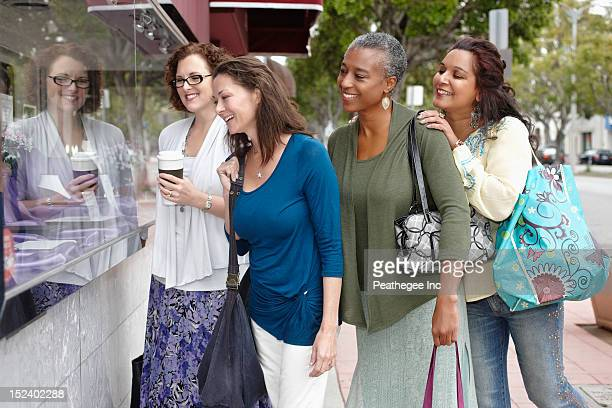 Friends shopping together in city