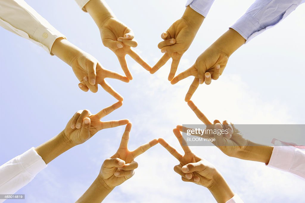 Friends Showing Peace Sign With Finger