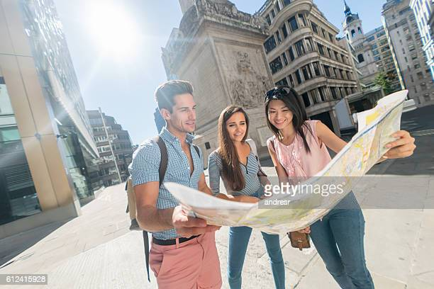 Friends sightseeing and looking at a map