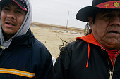 Friends sing Comanche and Kiowa warrior songs at the grave of Joshua Ware a native american Marine killed in Iraq on November 16 2005These images are...