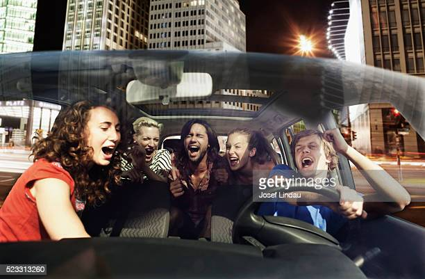 Friends singing in a car