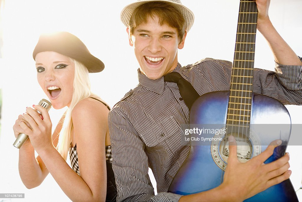 Friends singing in band together : Stock Photo