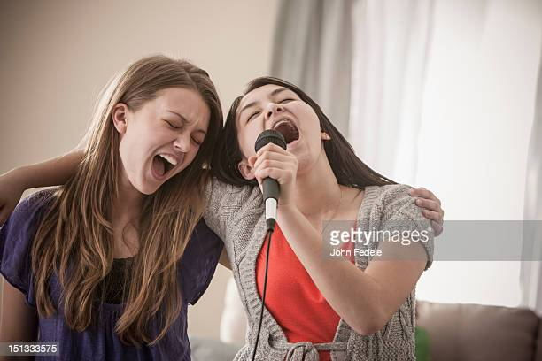 Friends singing karaoke together