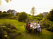 Friends sitting around outdoor dining table
