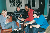 Friends Sitting Drinking in a Bar