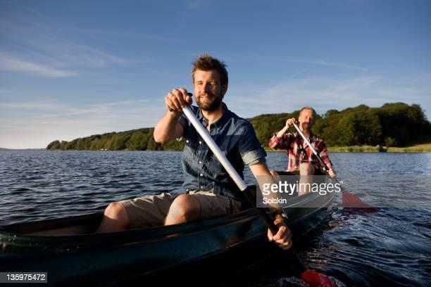 Friends sitting in canoe