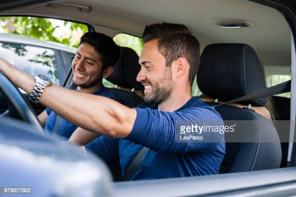 Friends sitting in the car ready to start vacations