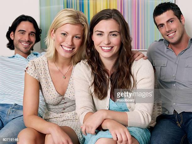 Friends Sitting on Sofa