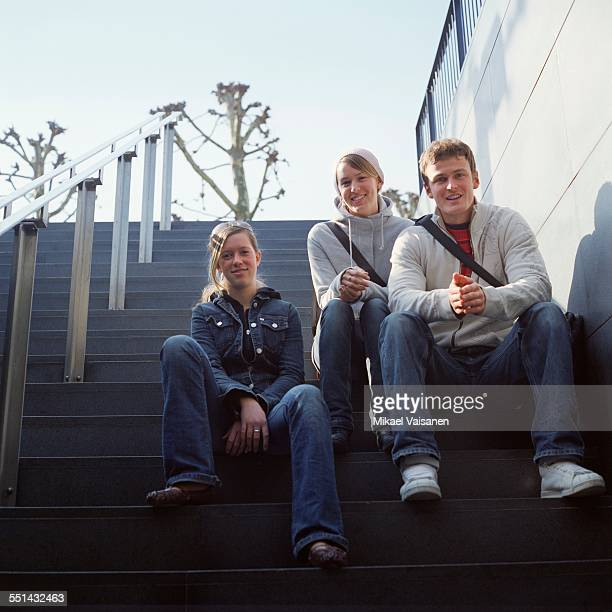 Friends Sitting on Stairs