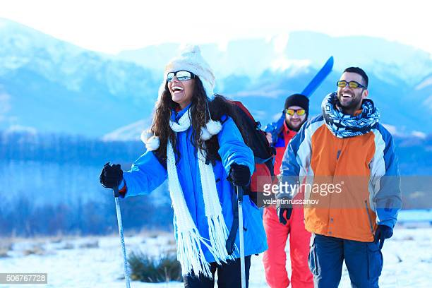 Friends skiing in the winter mountain