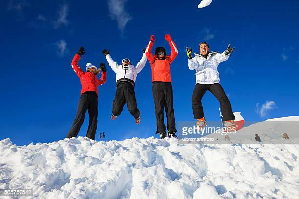 Friends snow skiers happy jumping fun  Top  winter Alps mountains