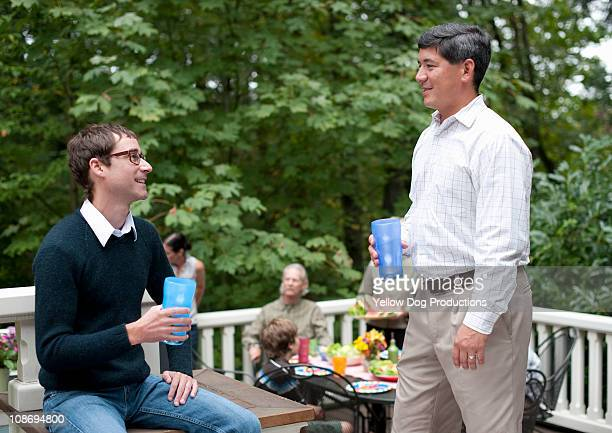 Friends socializing at neighborhood barbecue