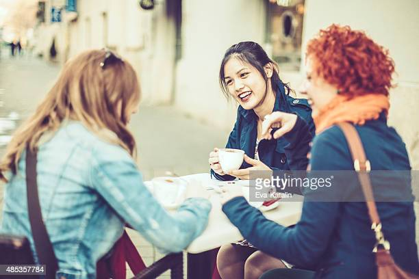 Friends spending time together in a coffee shop