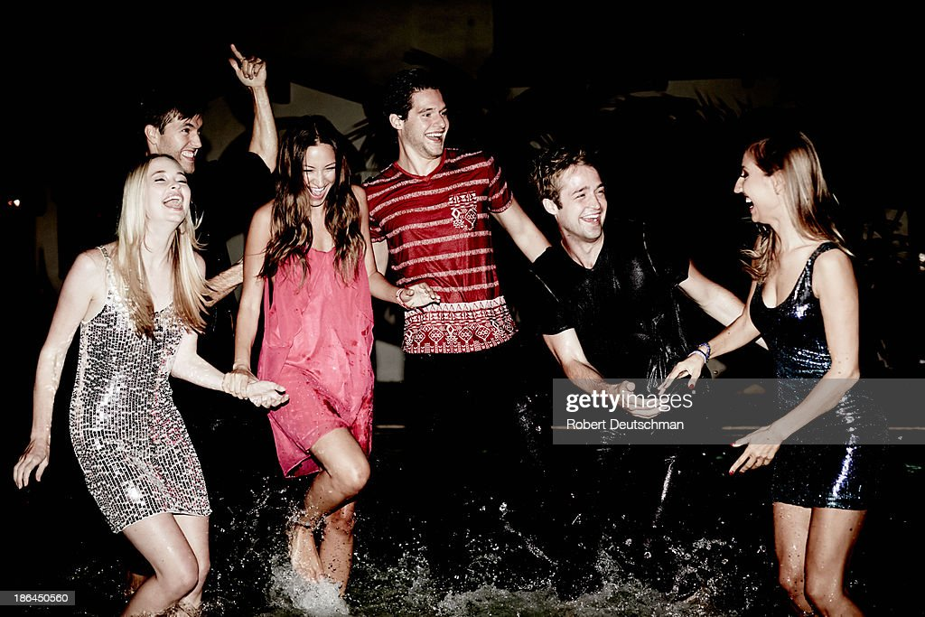 Friends splashing in the water together. : Stock Photo