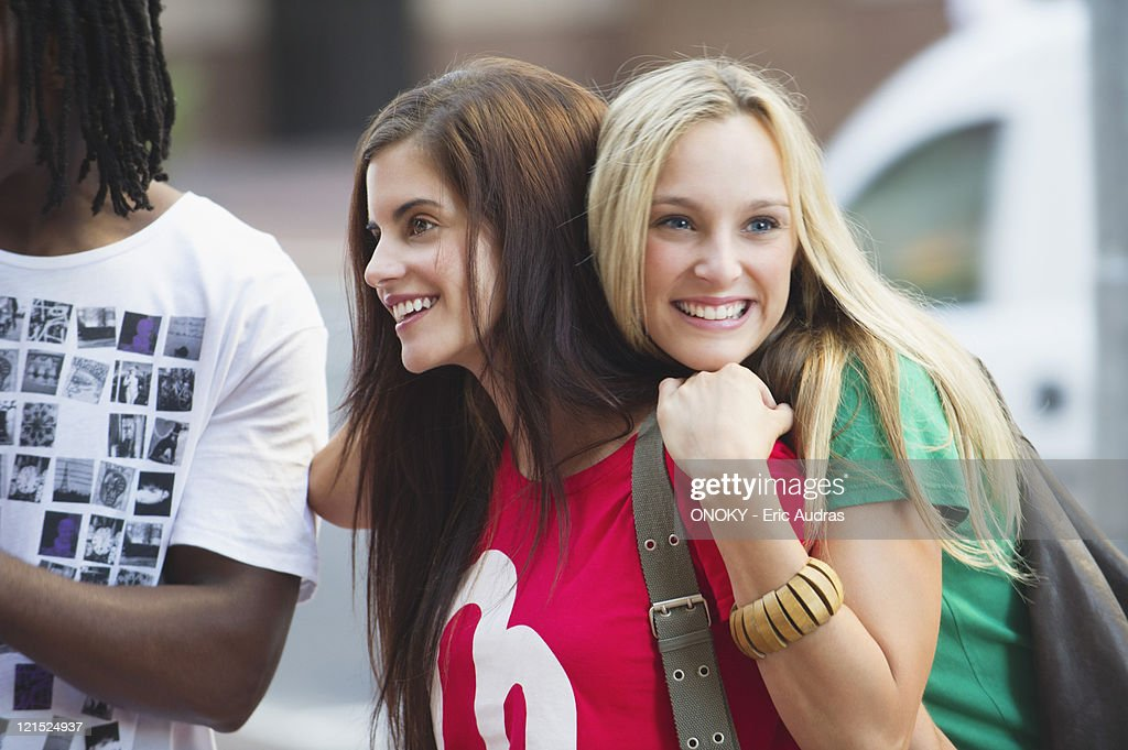 Friends standing together and smiling : Stock Photo