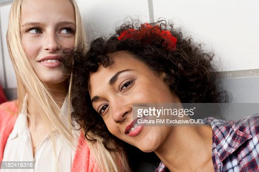 Friends standing together on city street : Stock Photo