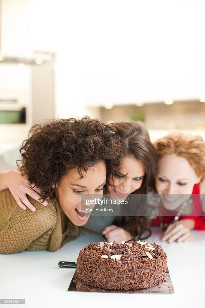 Friends staring chocolate cake : Stock Photo