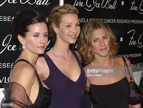 'Friends' stars Courteney Cox Arquette left Lisa Kudrow center and Jennifer Aniston arrive at the 10th Annual Fire Ice Ball December 11 2000 at the...
