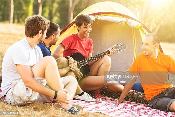 Friends storytelling at camping