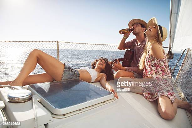 Friends summer vacation: on a sailing yacht