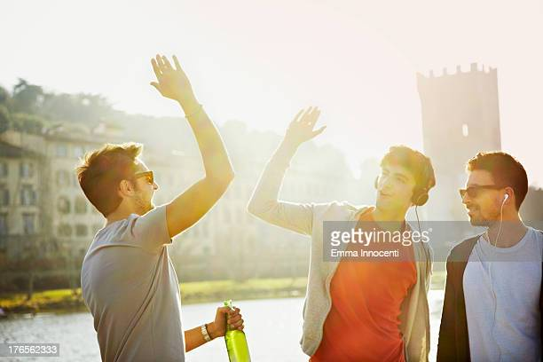 Friends, sunset, beer, high five, river banks