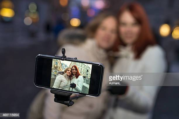 Friends take a selfie on a winter afternoon in the city