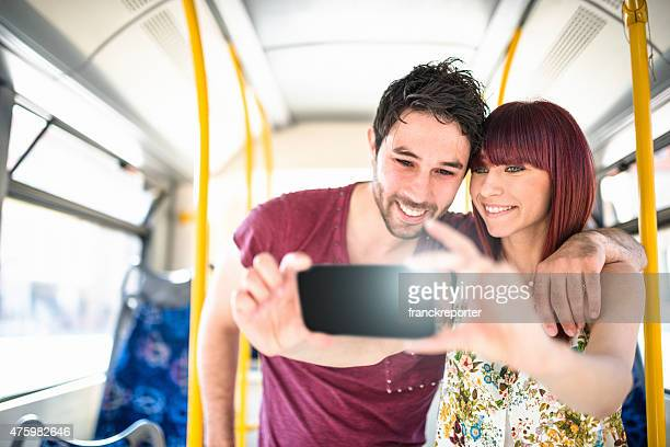 Friends take a selfie on the bus