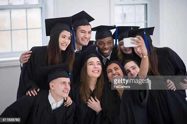 Friends Taking a Selfie After Graduation