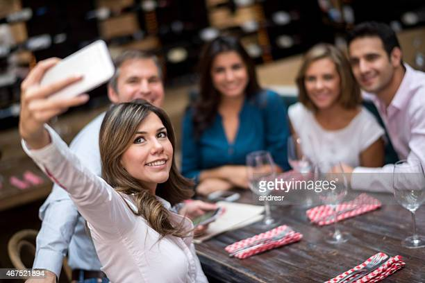Friends taking a selfie at a restaurant