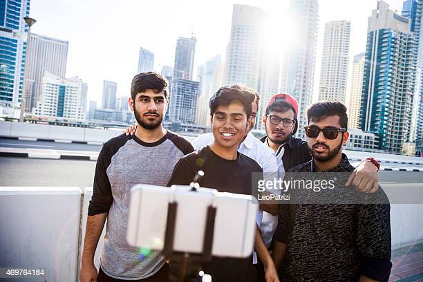 Friends taking a selfie in Dubai Marina during a vacation