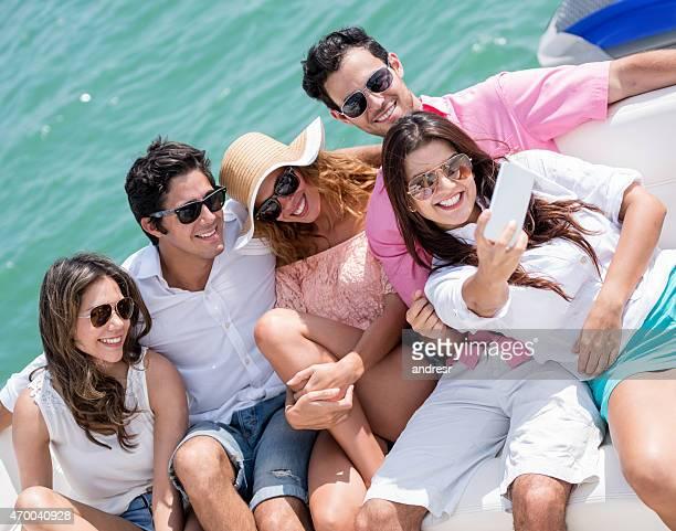 Friends taking a selfie on a yacht