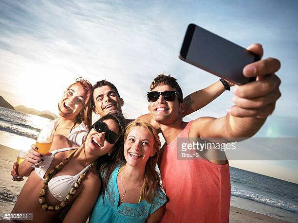 Friends taking a selfie on the beach.