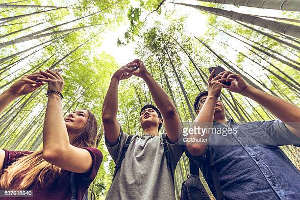 Friends taking bamboo forest pictures at Arashiyama, Kyoto, Japan