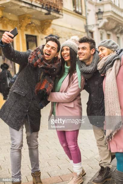 Friends taking cell phone selfie