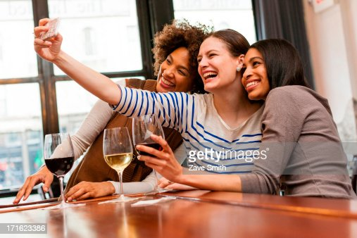 Friends taking photos using smart phone