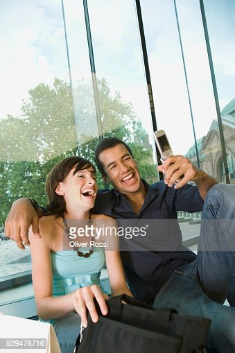 Friends taking picture with camera phone : Stock Photo
