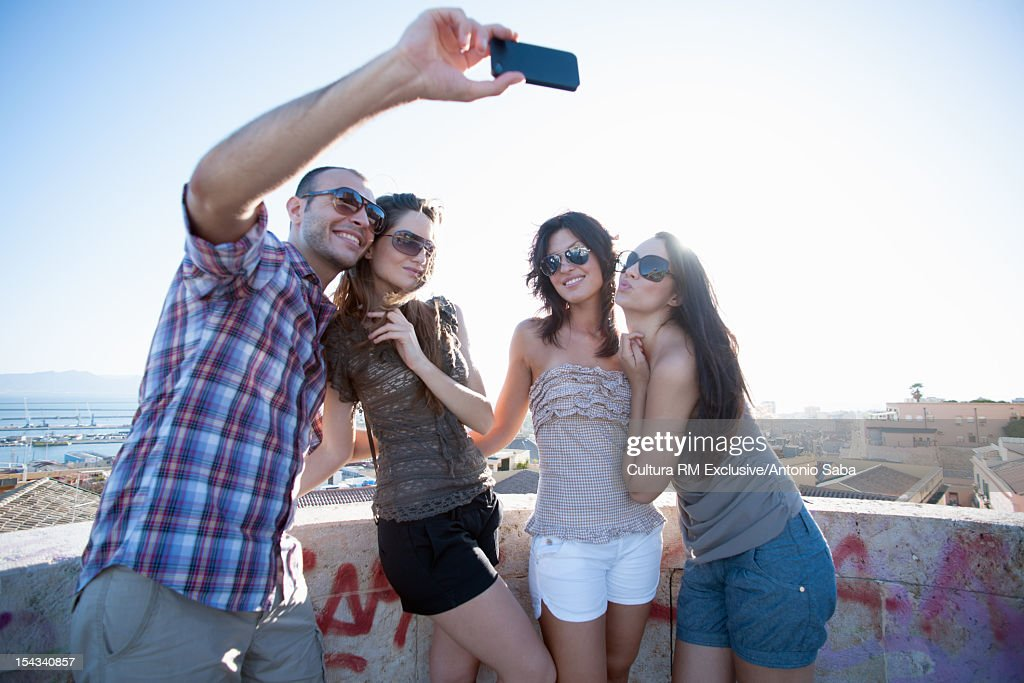 Friends taking pictures of themselves : Stock Photo