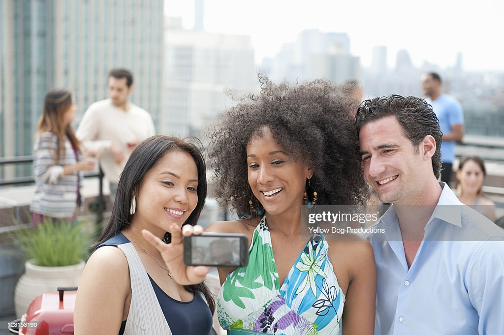 Friends taking self portrait with smartphone : Stock Photo