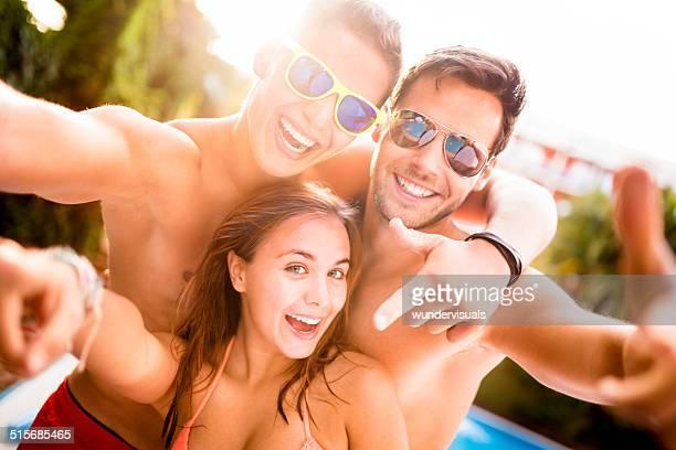 Friends Taking Selfie At Poolside