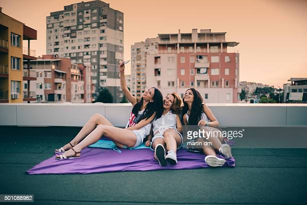 Friends taking selfie on the rooftop
