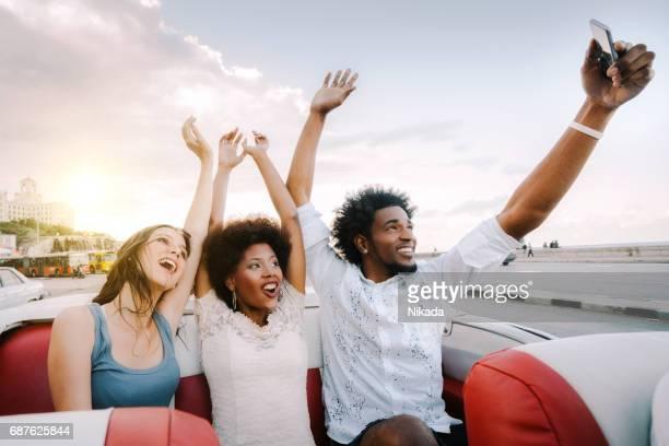 friends taking selfie with smartphone, Malecon, Havana, Cuba