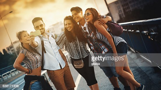 Friends taking selfies. : Stock Photo