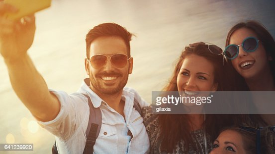 Friends taking selfies.