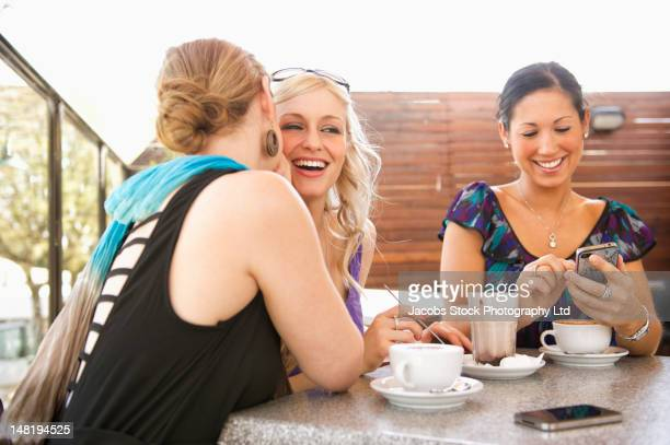 Friends talking and drinking coffee