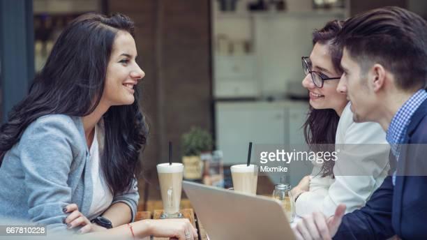 Friends talking and having a coffee break