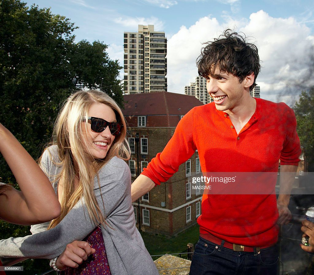 Friends talking at a party : Stock Photo