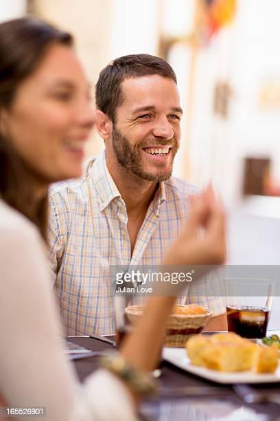 Friends talking at dinner